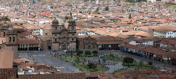 Plaza De Armas, Cusco, Peru. Lively urban gathering place offering colonial arcades, a cathedral, gardens & a central fountain Royalty Free Stock Photography