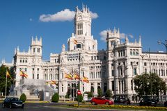 Plaza de Cibeles and City Hall in central Madrid with refugees sign. Madrid city hall, refugees in Spain Royalty Free Stock Photo