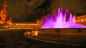 Plaza de Espana fountain panorama. 180 degree panoramic view of the pink fountain at Plaza de Espana square in Seville city by night, Andalusia, Spain stock video footage