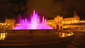 Plaza de Espana night panorama. 180 degree panoramic view of the pink violet fountain at Plaza de Espana square in Seville city by night, Andalusia, Spain stock video footage