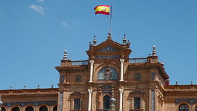 Plaza de Espana palace. Central palace building   with spanish flag waving in Plaza de Espana square in Seville city stock video footage