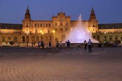 Plaza de Espana Sevilla, Andalucía, España, Europa. Night photography of the Plaza de Espana with illuminated fountain and tourists Royalty Free Stock Images