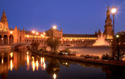 Plaza de espana Sevilla at night. Spanish square (Plaza de Espa�a) in Sevilla at dusk, with the canal, palace, tower and fountain stock images