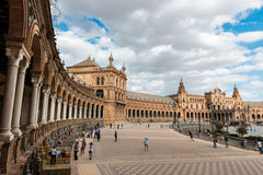 Plaza de Espana in Seville, Andalusia. Sevilla, Spain - September 19, 2015: Wide-angle view of a crowded Plaza de España in Seville, Spain, a square built in Royalty Free Stock Photo