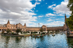 Plaza de Espana in Seville, Andalusia. Seville, Spain - September 19, 2015: Wide-angle view of a crowded Plaza de España in Seville, Spain, a square built in Royalty Free Stock Photos