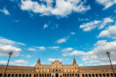 Plaza de Espana in Seville, Andalusia. Wide-angle view of the Plaza de España in Seville against a cloudy blue sky, a square built in 1928 for the Ibero Stock Photo