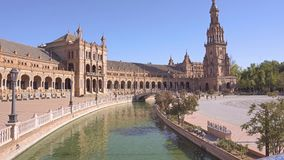 Plaza de Espana in Seville. Seville,Spain-august 7,2017:tourists stroll and admire the famous plaza de Espana in Seville during a sunny day stock video footage