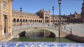 Plaza de Espana in Seville. Seville,Spain-august 7,2017:tourists stroll and admire the famous plaza de Espana in Seville during a sunny day stock video