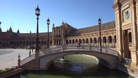 Plaza de Espana. Seville,Spain-august 7,2017:tourists stroll and admire the famous plaza de Espana in Seville during a sunny day stock footage