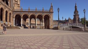Plaza de Espana in Seville. Seville,Spain-august 7,2017:tourists stroll and admire the famous plaza de Espana in Seville during a sunny day stock footage
