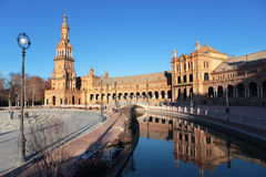 Plaza de Espana in Seville, Spain. Seville, Spain - January 3, 2012: People walking and making photos on Plaza de Espana. Built in 1928, Plaza de Espana is a Royalty Free Stock Photos