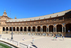 Plaza de Espana and tourists- Spanish Square in Seville, Andalusia, Spain Stock Image