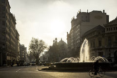 Plaza de Gracia in Barcelona,Spain. Plaza de Gràcia with the fountain in against light of late afternoon stock image