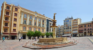 Plaza de la Constitucion fountain and shops Malaga Spain. Royalty Free Stock Images