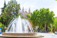 Plaza de la Reina Palma de Mallorca. Famous Plaza de la Reina and Boulevard Passeig del Born roundabout water fountain junction near the La Seu Cathedral and Stock Image