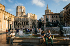 Plaza de la Virgen Cathedral Square in Valencia in the evening. Valencia, Spain - June 3, 2017: Tourists and locals meet in the evening on Plaza de la Virgen Royalty Free Stock Photography