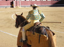 Plaza del Torros, Barcelona. The Plaza del Torros in Barcelona - bull fighting arena, man on horse, horse wearing protective wrapping royalty free stock photo