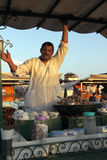 Plaza Djem el fnaa in Marrakech. Djem el Fna Plaza in Marrakech, a seller of snails to eat stock photography