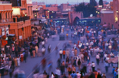 Plaza Djemaa El Fnaa. In Marrakech, showing a busy street with many people and traveling vehicles Stock Photos