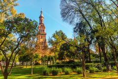 Plaza Espana in Sevilla , Spain. View of the Tower on Plaza Espana from the Park of Maria Luisa (Parque de Maria Luisa). Seville (Sevilla), Andalusia, Spain royalty free stock photo