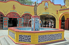 Plaza With Fountain. This plaza with an inviting and relaxing water fountain can be found at Knotts Berry Farm in Buena Park, California Stock Images