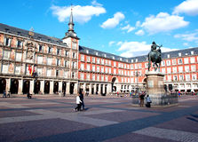 Plaza Mayor. Tourists stroll in the ancient Madrid Plaza Mayor, Spain. Photograph taken on October 13th, 2010 stock images