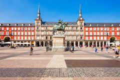 Plaza Mayor is a central plaza in Madrid, Spain. MADRID, SPAIN - SEPTEMBER 20, 2017: The tourists at the Plaza Mayor or Main Square, a central plaza in the city stock image