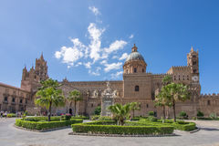 Plaza outside building in Palermo, Italy. Plaza with palm trees and shrubs outside imposing brick building in Sicilian city of Palermo, Italy on sunny day stock images