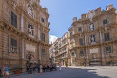 Plaza in Palermo, Italy. Statues in archways of buildings surrounding a plaza in Palermo, Italy on sunny day stock photo
