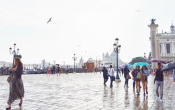 Plaza at Port of Venice. Plaza with passing people along port of Venice on a rainy afternoon royalty free stock photos