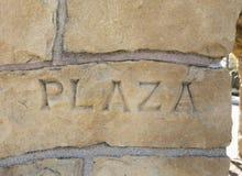 Plaza som inskrivas i sandstendetalj royaltyfria foton