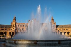 Plaza of Spain Seville at Plaza de España fountain with rainbow royalty free stock image