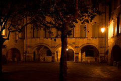 Plaza in Uzes France by night. The central plaza in the medieval town of Uzes in Lanuedoc France by  night. Originally a Roman city. today its a cool place to Stock Photo