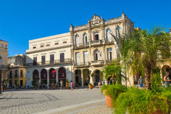 Plaza Vieja, Havana, Cuba. Havana, Cuba - December 19, 2016: Tourists admire old architecture in Plaza Vieja Old Square, one of the four main squares in Havana Royalty Free Stock Photos