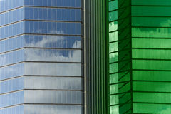 Plaza Windows With Green Tint. Blue Sky And Clouds Reflected On Plaza Windows Royalty Free Stock Images