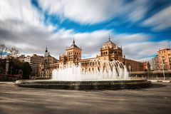 Plaza Zorrilla and Cavalry Academy of Valladolid. Fountain in the Plaza Zorrilla square in Valladolid, with the Cavalry Academy building in the background. Long Royalty Free Stock Image