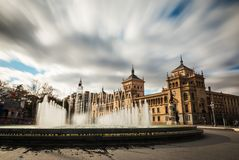 Plaza Zorrilla and Cavalry Academy of Valladolid. Fountain in the Plaza Zorrilla square in Valladolid, with the Cavalry Academy building in the background. Long Stock Images