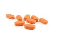 Píldoras anaranjadas, medicamentos de venta con receta Imagen de archivo libre de regalías