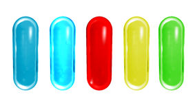 Píldoras coloridas aisladas en el fondo blanco Imagen de archivo libre de regalías