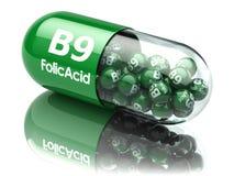 Píldoras con el elemento del ácido fólico b9 Suplementos dietéticos Vitamina C Foto de archivo