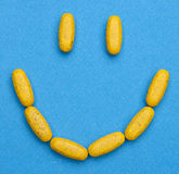 Píldoras felices Imagenes de archivo