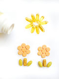 Píldoras felices de la vitamina Imagenes de archivo