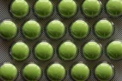 Píldoras verdes Fotos de archivo libres de regalías