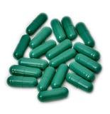 Píldoras verdes Fotografía de archivo libre de regalías
