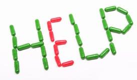 Píldoras verdes del rojo del anuncio Imagen de archivo libre de regalías
