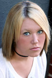 Pleading Eyes. Closeup portrait of a serious blond young woman with pleading eyes royalty free stock images