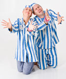 Pleading Prisoners. Two pleading prisoners in theatrical costumes Royalty Free Stock Photo