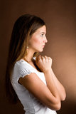 Pleading woman. A beautiful woman entreating somebody of something Royalty Free Stock Photos