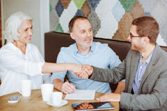Pleasant aged couple meeting with sales manager Stock Image
