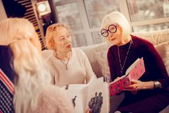 Pleasant aged women having a book club meeting royalty free stock image